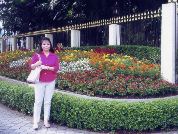 Mariel with flowers in Malaysia